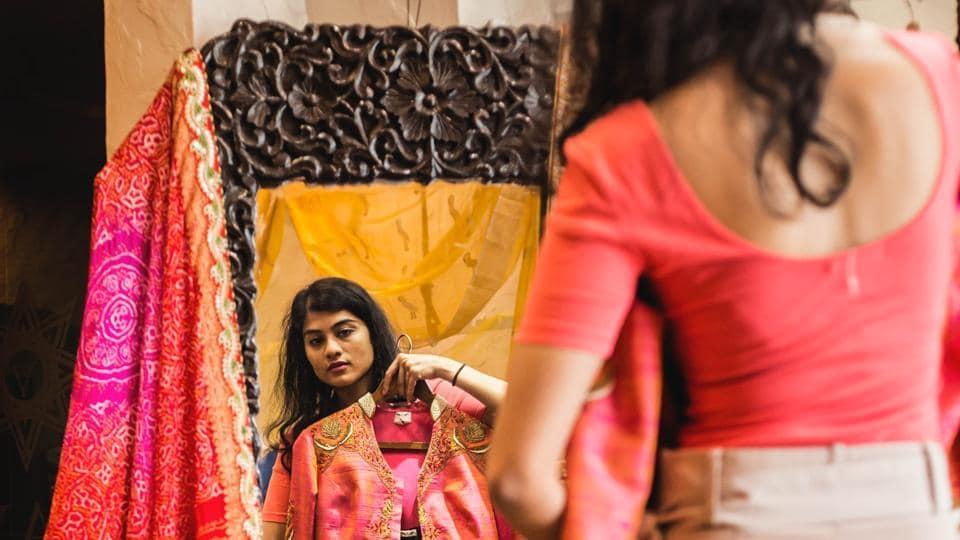 A blogger at Asha Gautam's store, buying handwoven and pure silk saris.