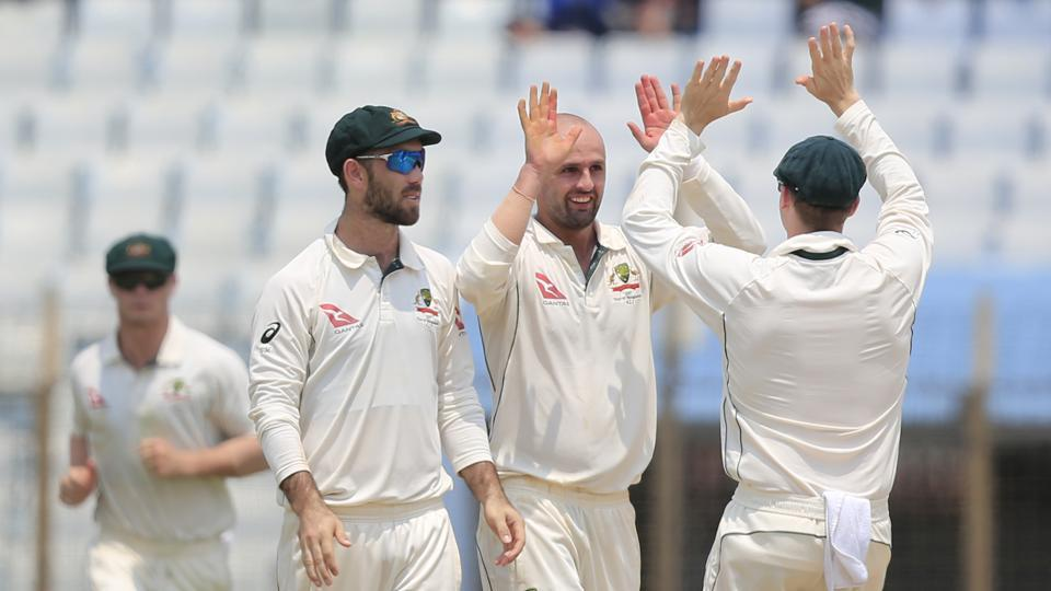 Australia's Nathan Lyon, second right, picked up five wickets on the first day of the second Test against Bangladesh in Chittagong on Monday. Get full cricket score of Bangladesh vs Australia, 2nd Test, Day 1, here.