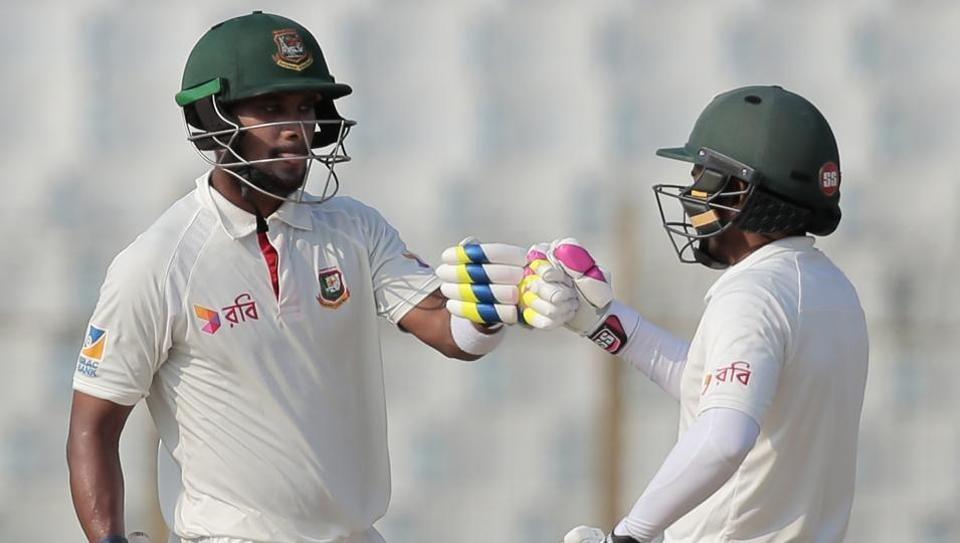 Bangladesh captain Mushfiqur Rahim(R)and teammate Sabbir Rahman hit a crucial 105-run partnership which revived their innings against Australia onDay 1 of the second Test in Chittagong.
