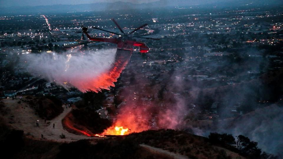 A wildfire on the northern edge of Los Angeles on Saturday fanned into what the mayor called the largest blaze in the city's history, prompting evacuation of hundreds of people and closure of a major highway. Spread over nearly 5,900 acres and named after the canyon area where it erupted on Friday, La Tuna has led authorities to evacuate more than 700 homes in a north Los Angeles neighbourhood and in nearby Burbank and Glendale. (Kyle Grillot / REUTERS)