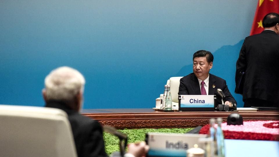 Chinese President Xi Jinping and Prime Minister Narendra Modi attend the plenary session during the BRICS Business Forum the BRICS Summit in Xiamen, Fujian province on September 4, 2017.