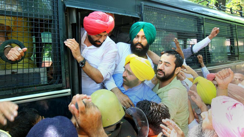 Aam Aadmi Party leaders being taken to Sector 17 police station in Chandigarh on Monday.
