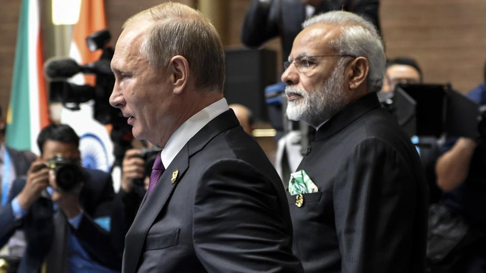 Russian President Vladimir Putin with Prime Minister Narendra Modi at BRICS Summit in Xiamen, China, on Monday.