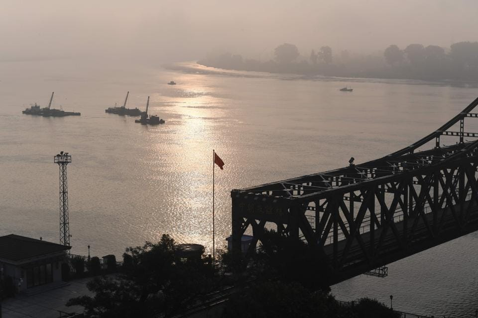 The Friendship Bridge, which connects the North Korean town of Sinuiju (at rear) to the Chinese border city of Dandong, on September 4. The Global Times editorial said if China 'completely cuts off the supply of oil to North Korea or even closes the China-North Korea border', it will still be uncertain whether China can deter Pyongyang from conducting further nuclear tests.