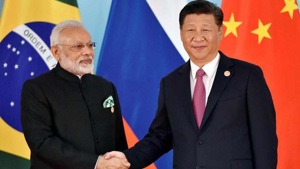 Chinese President Xi Jinping with Prime Minister Narendra Modi during the BRICS Summit at the Xiamen International Conference and Exhibition Center in Xiamen, China, on September 4.