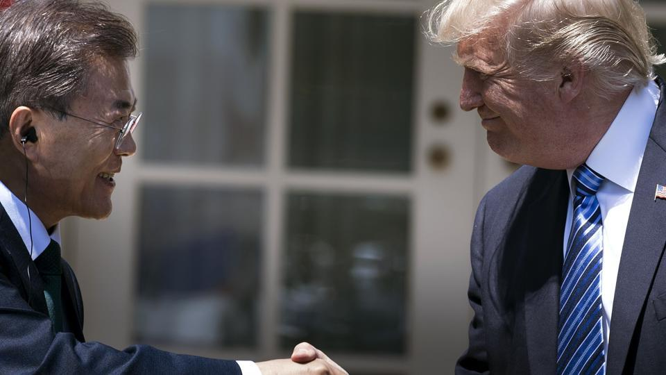(FILES) This file photo taken on June 30, 2017 shows South Korea's President Moon Jae-in and US President Donald Trump shaking hands in the Rose Garden of the White House in Washington, DC.