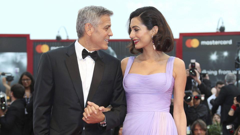 Director George Clooney and his wife Amal Clooney pose for photographers upon arrival at the premiere of the film Suburbicon during the 74th edition of the Venice Film Festival in Venice, Italy.