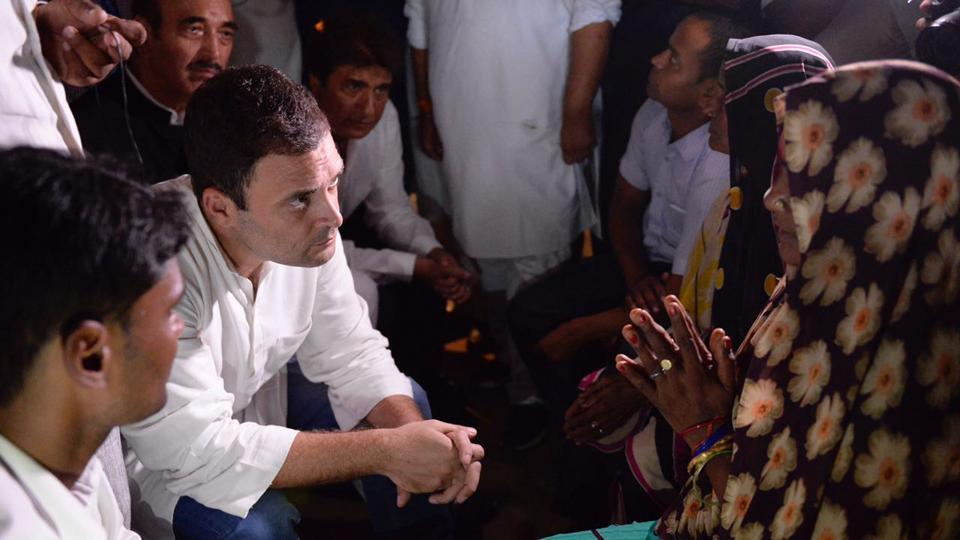 Congress vice president Rahul Gandhi talks to people during a visit to Gorakhpur. He will visit Gujarat and speak with party workers and listen to their grievances. (HT file photo)