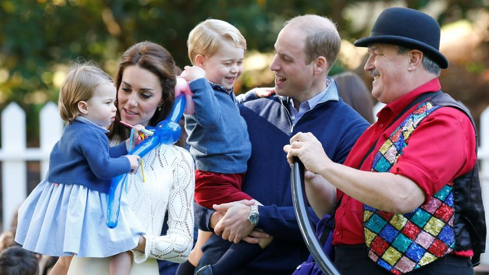 A file photo of Britain's Prince William and Catherine, Duchess of Cambridge, with their children Prince George and Princess Charlotte at Government House in Victoria, British Columbia, Canada.