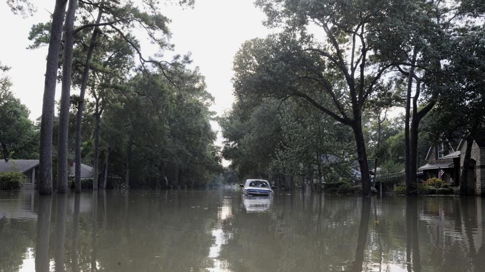 A neighbourhood in Houston that was flooded after hurricane Harvey struck the region. Two Indians who were rescued from a lake have died.
