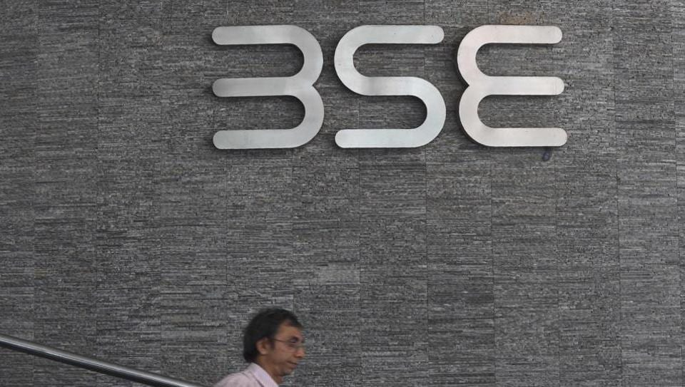 An officegoer walks past the Bombay Stock Exchange  logo at the BSE building in Mumbai on July 25, 2017.