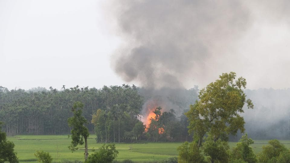 Smoke rises from what is believed to be a burning village in the southern Maungdaw area of Myanmar's Rakhine state on September 4, 2017.