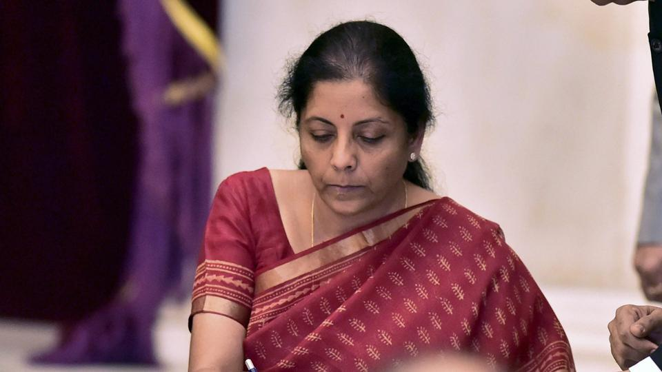 Nirmala Sitharaman signing the register after taking oath as a cabinet minister in New Delhi on Sunday.