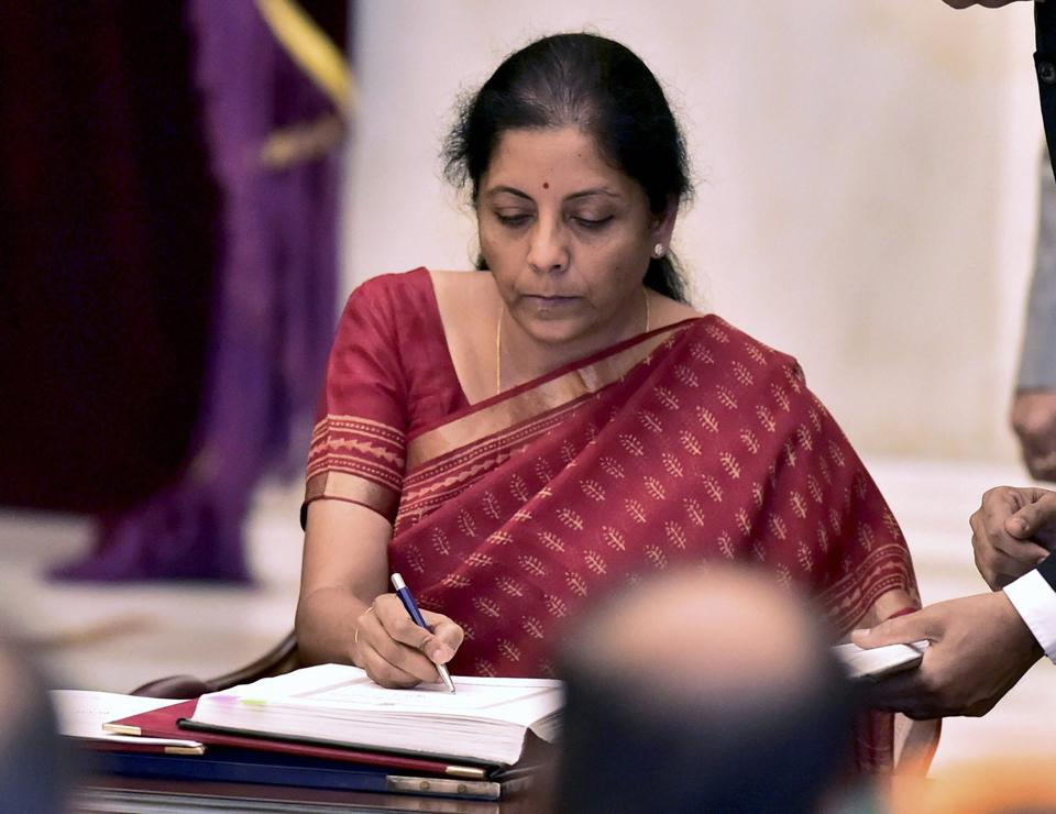 Nirmala Sitharaman signing the register after taking oath as a cabinet minister at Rashtrapati Bhavan in New Delhi on Sunday. Sitharaman has become India's 2nd woman defence minister after Indira Gandhi.