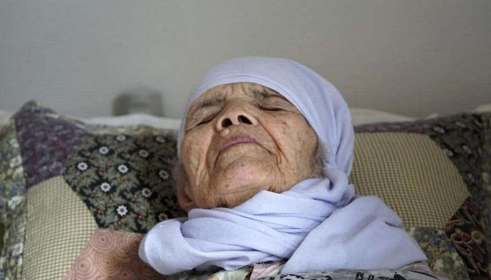 106-year old Afghan refugee Bibihal Uzbeki lies in bed in Hova, Sweden, Sunday, Sept. 3, 2017, and despite being severely disabled and barely able to speak, she is facing deportation from Sweden after her asylum application was rejected.