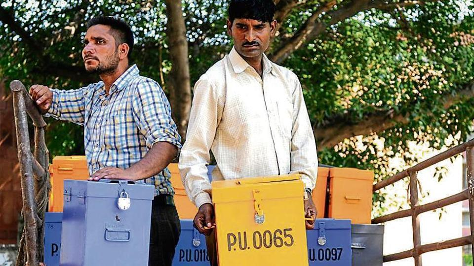 Workers carrying ballot boxes ahead of the student elections at Panjab University in Chandigarh; the polls are scheduled to be held on September 7.
