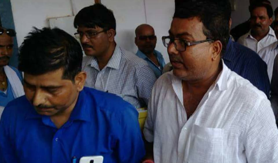 Muzaffarpur Municipal Corporation ward councillor Rakesh Kumar Sinha Pappu  being taken to the special CBI court in connection with Navruna case on Tuesday.