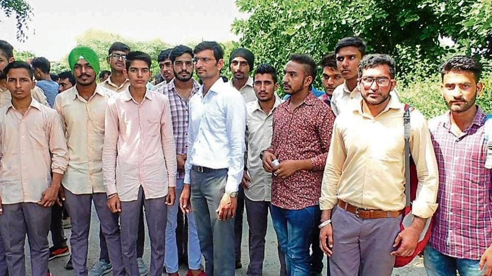 Students at the district administrative complex in Sirsa on Monday.