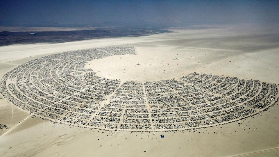 Black Rock City, a gathering of approximately 70,000 people that is created annually for the Burning Man arts and music festival dedicated to community, art, self-expression, and self-reliance, is seen in the Black Rock Desert of Nevada. This temporary city emerges every year and is dismantled after the festival, leaving behind no trace of its existence. (Jim Bourg / REUTERS)