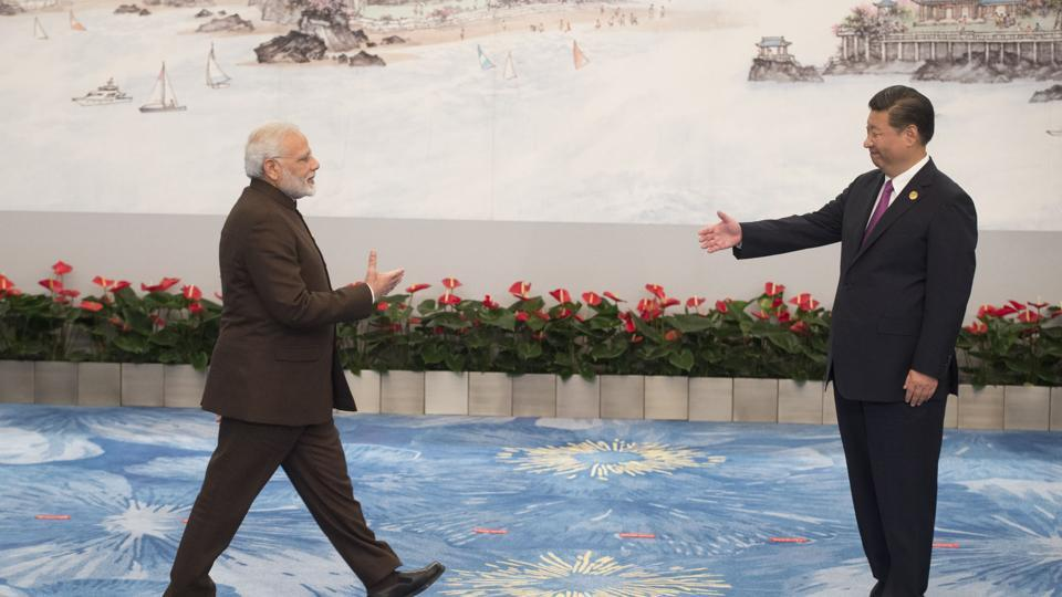 Chinese President Xi Jinping welcomes Prime Minister Narendra Modi for a banquet dinner during the BRICS Summit in Xiamen, Fujian province on September 4.