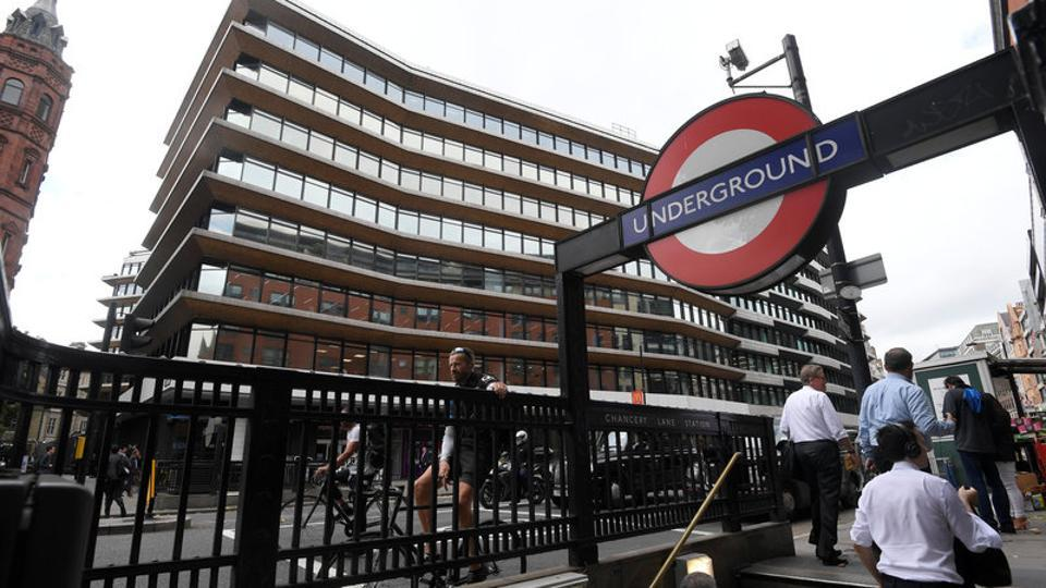 An office building containing the London headquarters of the PR company Bell Pottinger is seen behind an entrance to an underground train station in London on September 5, 2017.
