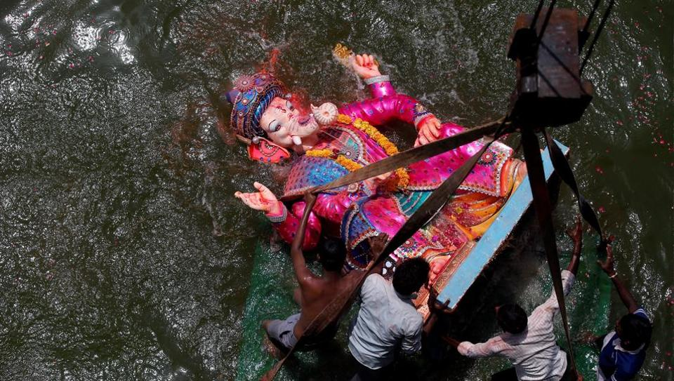Devotees immerse an idol of the Ganesh into the Sabarmati river on the last day of the Ganesh Chaturthi festival in Ahmedabad on September 5.