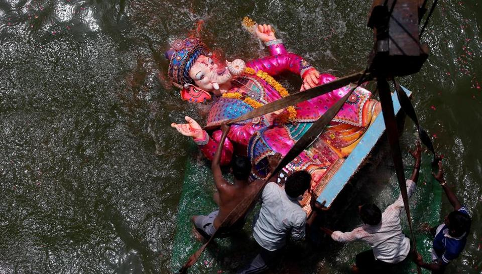 The immersion of Ganesha idols amid chants of Ganpati Bappa Moraya, Pudhchya Varshi Lavkar Ya (come back soon next year) today, marks the end  of  the 10 day Ganesh Chaturthi festival. During Ganeshotsav, devotees thronged pandals across the country, and feasted on sweets such as modak, which is considered Ganesha's favourite. (REUTERS/Amit Dave)