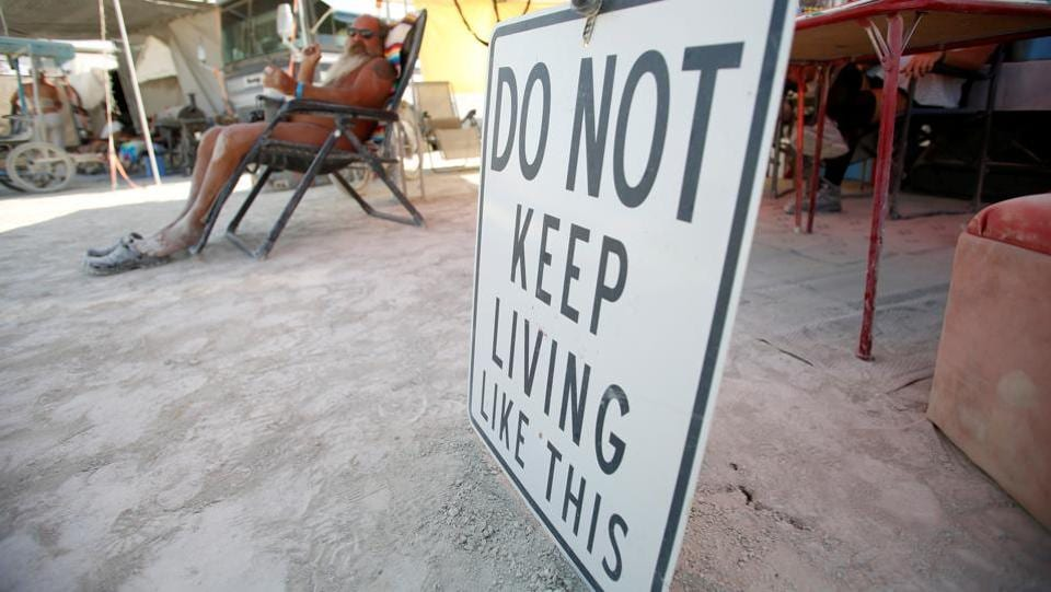 A sign at a theme camp lends words of wisdom for posterity to burners taking part in the 2017 Burning Man celebrations. (Jim Urquhart / REUTERS)