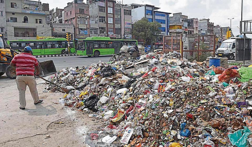 Garbage piles up outside a waste disposal area at Ganesh Nagar in New Delhi.