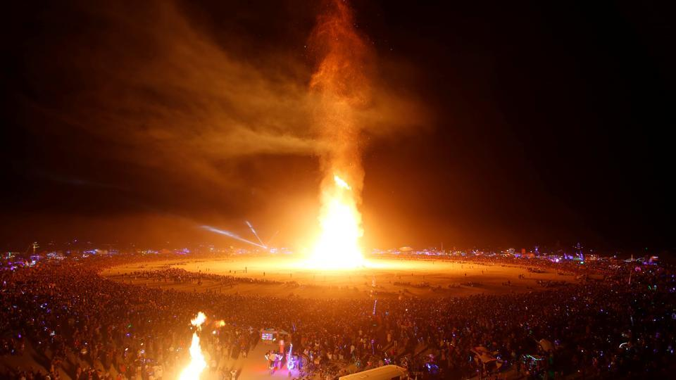 The Man is engulfed in flames with revellers surrounding it during the signature ceremony marking the end of the annual Burning Man arts and music festival in the Black Rock Desert of Nevada. (Jim Urquhart / REUTERS)
