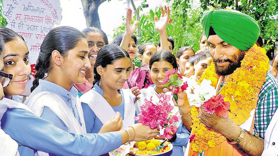 Government school students honour their lecturer Sukhdarshan singh in Patiala on Monday.