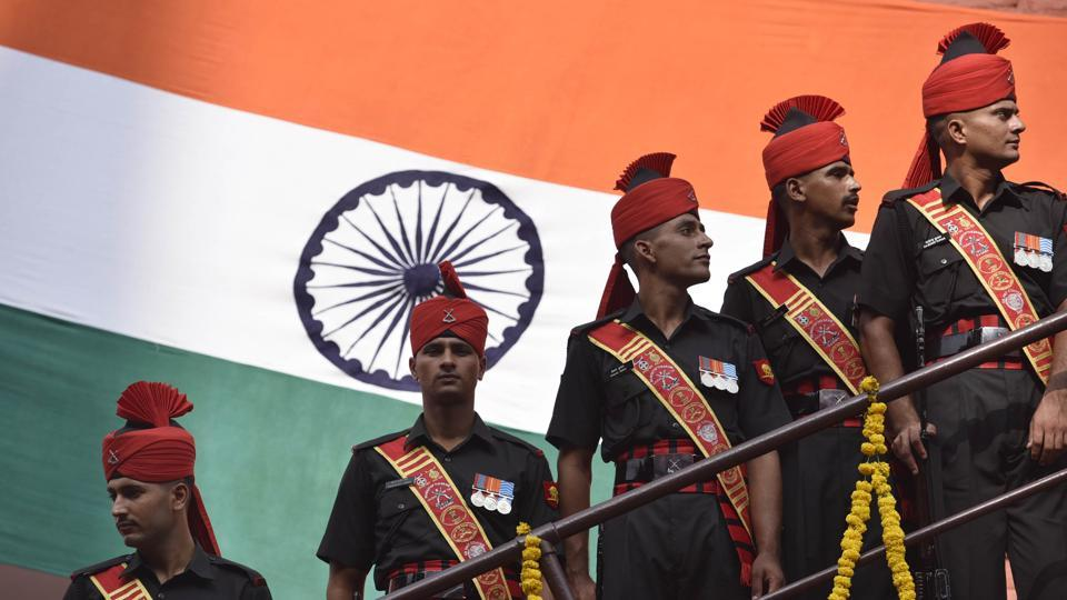 Army personnel pose in front of the national flag during the Independence Day celebrations. Former chiefs of the army will be briefed about the Doklam standoff at a special conclave.