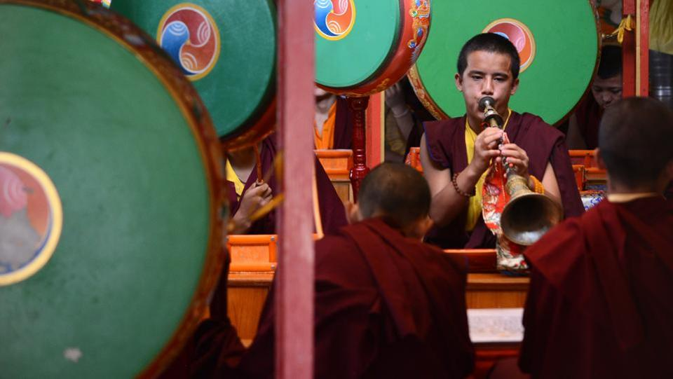Young monks play traditional musical instruments during the prayer for their spiritual guru Kyabje Taklung Tretrul Rinpochhe. 'We pray that the master is reborn. The process to find his reincarnation will start in October,' says Yarphel Lama, the administrator of the monastery. (Deepak Sansta / HT Photo)
