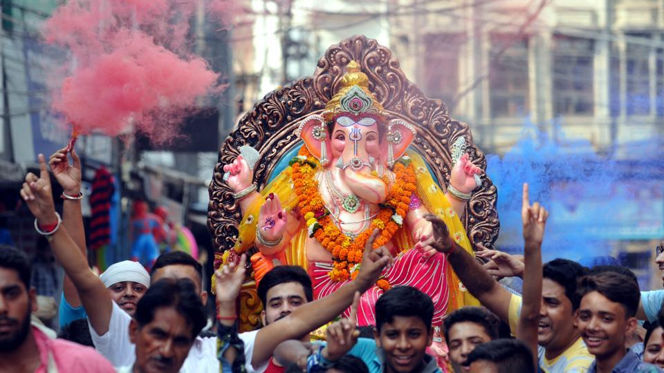 Devotees dancing during procession of Lord Ganesha on the eve of Ganesh immersion at Jalandhar on Thursday.