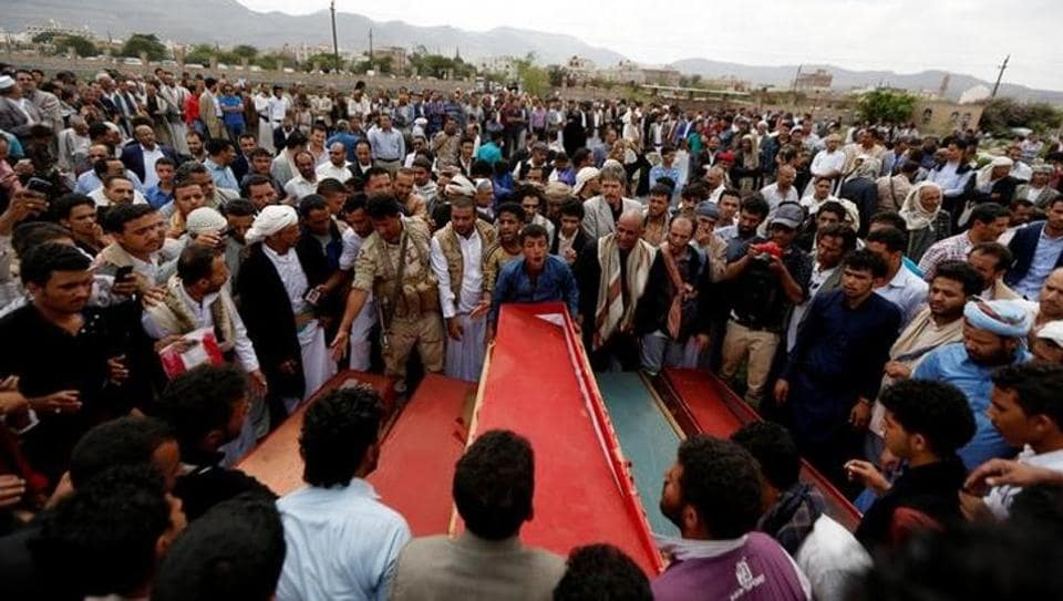 Mourners gather around coffins at a graveyard during the funeral of eight family members killed by a Saudi-led air strike in Sanaa, Yemen, August 26, 2017.