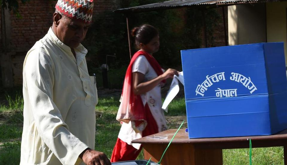 A Nepalese voter casts his ballot at a polling station in Nepalgunj. The Parliament has endorsed electoral laws  which bar people involved in corruption and criminal offences to stand as candidates.