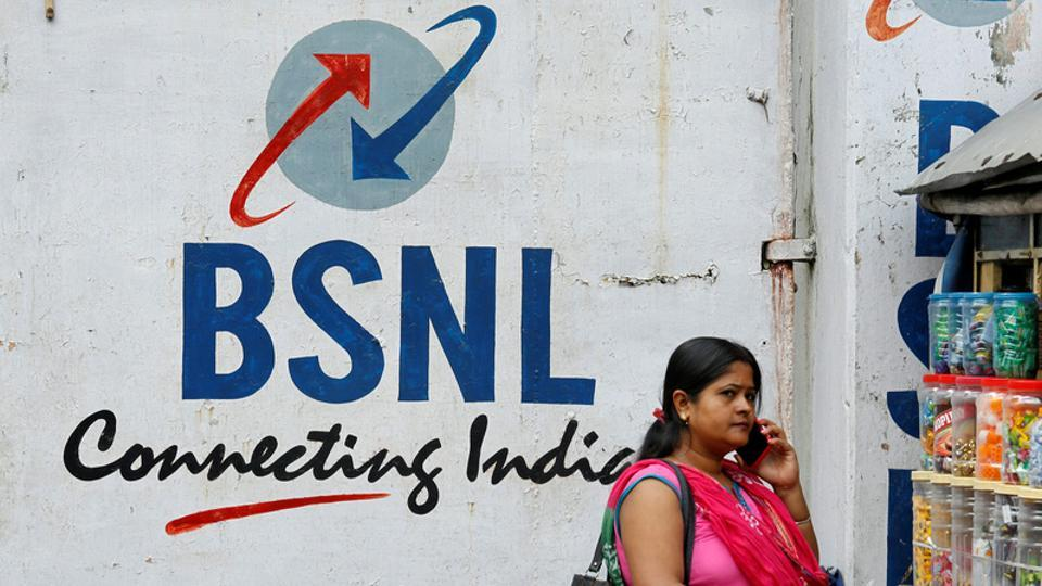 A woman speaks on her phone outside the BSNL office in Kolkata. BSNL has launched a new voice and data plan.