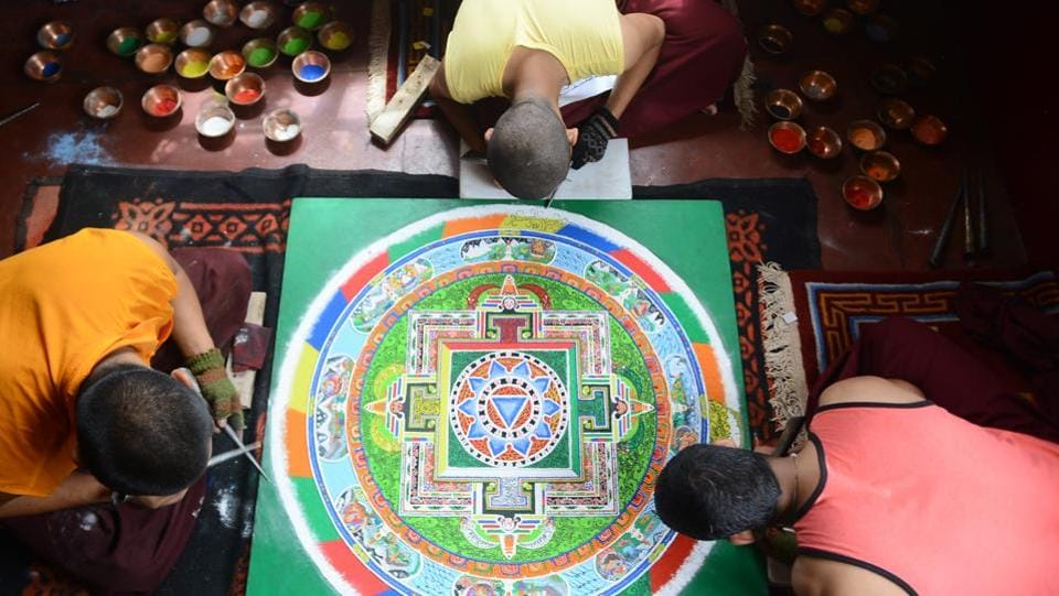 Monks make a mandala using natural colors ahead of a  prayer  ceremony for their spiritual guru Kyabje Taklung Tretrul Rinpochhe. He died at 89 at Bodh Gaya in 2015 when his disciples decided to bring the body back to Shimla and preserve it. Two attendants, who were with him round the clock, Geogang Wanchuk and Paljor, say Rinpoche died in meditation, a stage short of achieving nirvana. (Deepak Sansta / HT Photo)