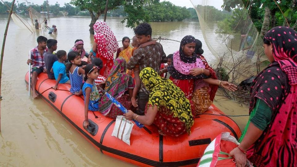 Flood-affected villagers are moved to a safer place after heavy rains at Pratapgarh village on the outskirts of Agartala, September 4, 2017.