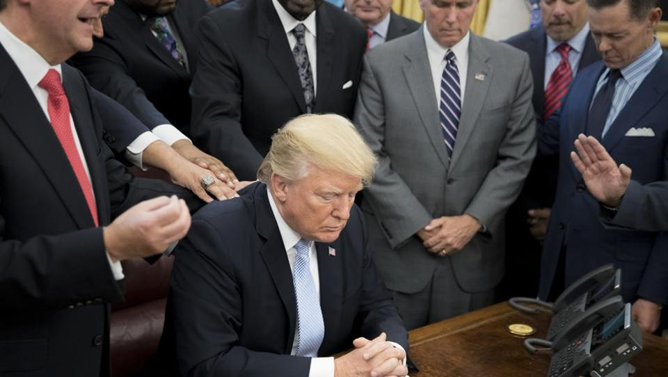President Donald Trump during a group prayer in the Oval Office at the White House in Washington on Sunday.