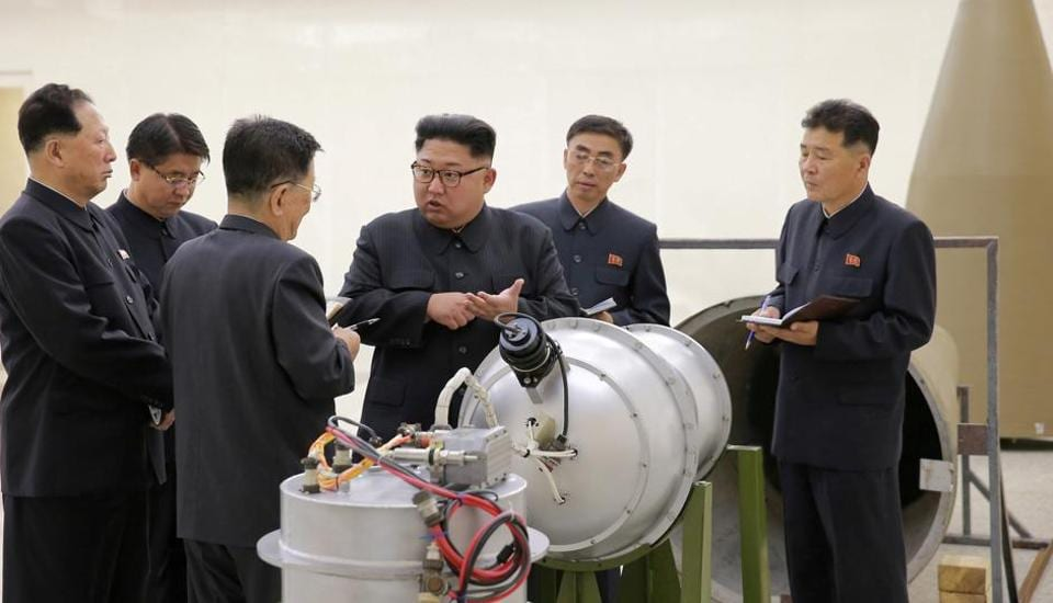 North Korean leader Kim Jong Un provides guidance with Ri Hong Sop (3rd L) and Hong Sung Mu (L) on a nuclear weapons program in this undated photo released by North Korea's Korean Central News Agency (KCNA) in Pyongyang September 3, 2017.