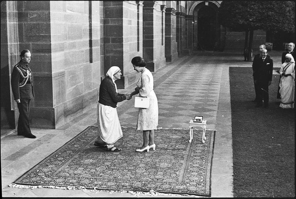 Queen Elizabeth II greets Mother Teresa during her meeting on November 24, 1983.  Anjezë Gonxhe Bojaxhiu, better known as Mother Teresa spent her life taking care of the poor and the destitute. Canonised in 2016 as Saint Teresa of Calcutta, she has now been chosen as the co-patroness of the Archdiocese of Calcutta. Her compassion and aid work for those suffering from leprosy, the terminally ill and society's outcasts made her a global icon of Christian charity. A dig through the HT archives sheds light on her persona. (Virendra Prabhakar / HT PHOTO)