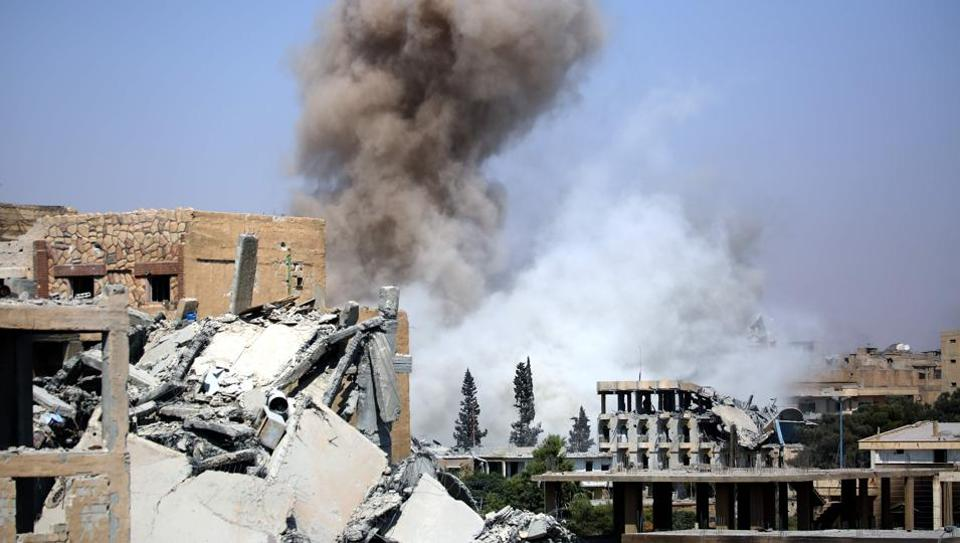 Smoke billows in Raqa on September 4, 2017, as Syrian Democratic Forces (SDF), a US backed Kurdish-Arab alliance, battle to retake the northern Syrian city from the Islamic State (IS) group.