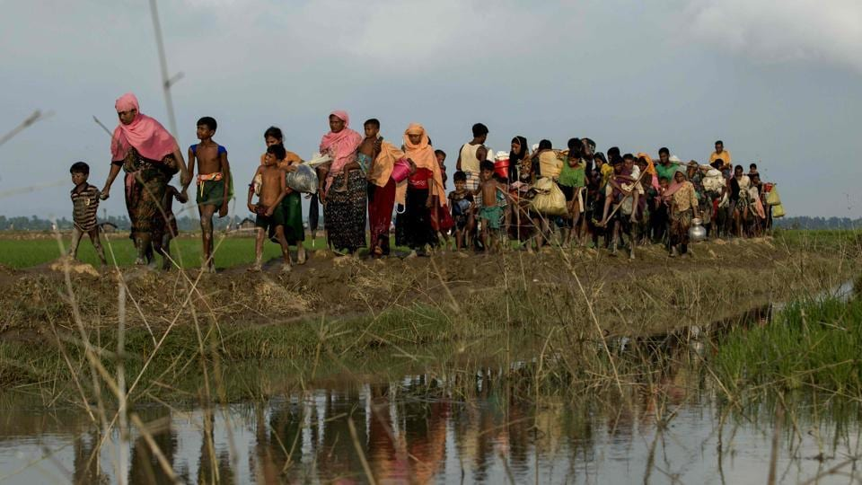Displaced Rohingya refugees from Rakhine state in Myanmar carry their belongings as they flee violence, near Ukhia, near the border between Bangladesh and Myanmar on September 4.