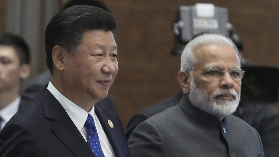 Prime Minister Narendra Modi and Chinese President Xi Jinping arrive for the Dialogue of Emerging Market and Developing Countries on the sideline of the BRICS Summit in Xiamen.
