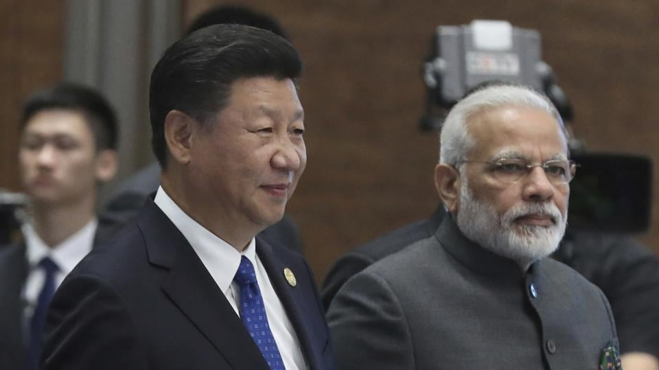 Chinese President Xi Jinping, left, and Indian Prime Minister Narendra Modi arrive for the Dialogue of Emerging Market and Developing Countries on the sideline of the BRICS Summit in Xiamen, China.