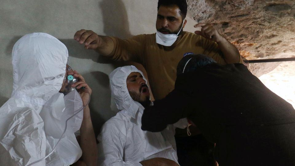 A civil defence member breathes through an oxygen mask, after what rescue workers described as a suspected gas attack in the town of Khan Sheikhoun in rebel-held Idlib, Syria.