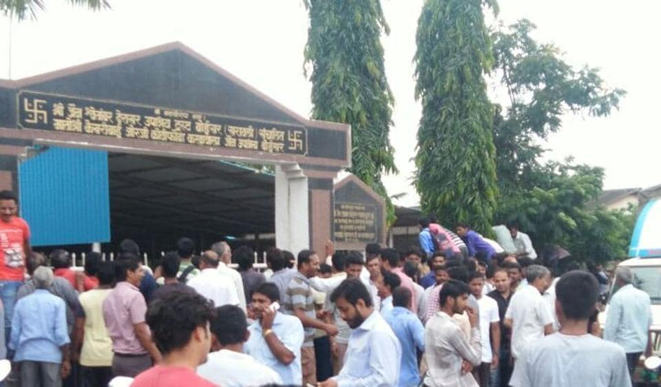 People gather outside the Jain temple in Boisar where the leopard had hid on Tuesday.