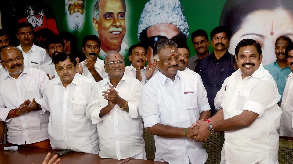 Tamil Nadu Chief Minister K Palaniswami (R) and O Panneerselvam exchange greetings following merger of their factions in Chennai.