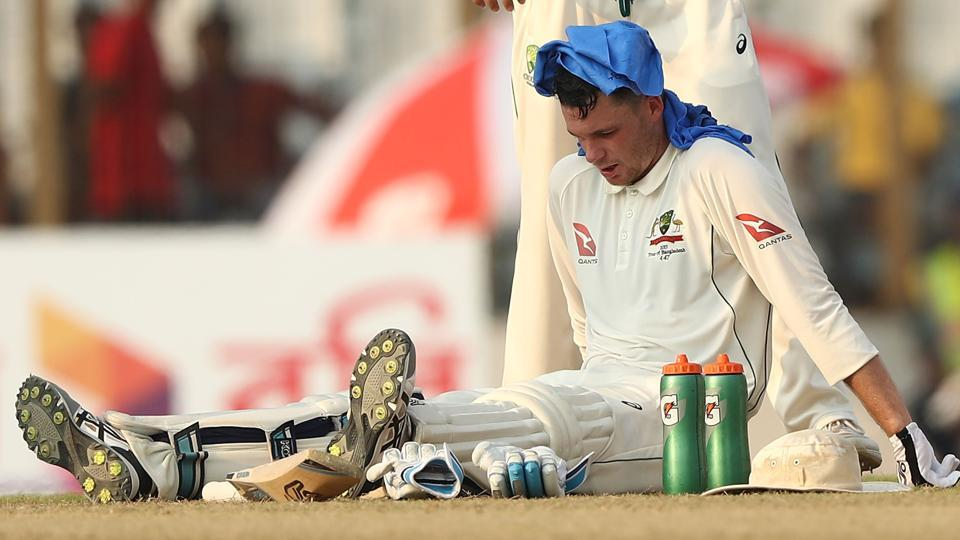 Australia cricket team batsman Peter Handscomb tries to cool things down with wet towel and electrolytes during his innings on Day 2 of the Second Test against Bangladesh cricket team in Chittagong on Tuesday.